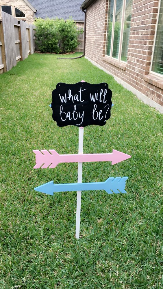 Gender reveal sign made with supplies purchased at Hobby Lobby.