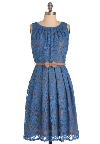 Love this dress with its lacy, leaf-patterned overlay, almond-colored lining, and bow-embellished taupe belt, this demure, yet flirtatious blue frock is the look your wardrobe has been longing for!