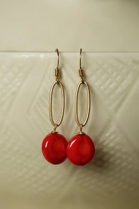 Unique handmade gemstone dangle earrings for women feature coral