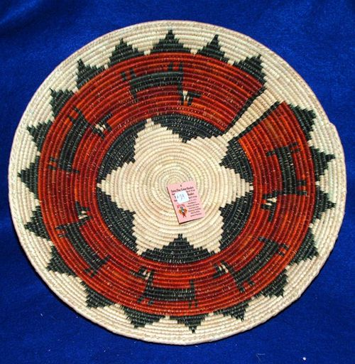 "A finely handwoven basket with a traditional Navajo star center & running deer.  Large 14.5"" width with a 3"" depth makes it perfect for fruit and party snacks.  Pretty enough to hang on your wall as an accent piece. $22.95 #basket #homedecor"