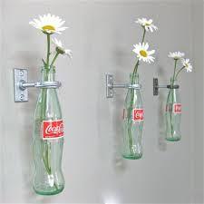 Imatges trobades pel Google de http://rmeeq.com/img/kitchen-awesome-3-cocacola-bottle-mount-on-wall-flower-vases-coke-for-50-s-diner-kitchen...