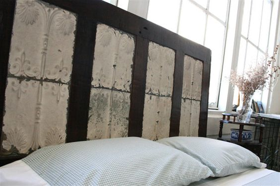 Love this headboard. Such a unique piece! The only thing that concerns me is that it was reclaimed from the Katrina flooding. It has been sealed, though.