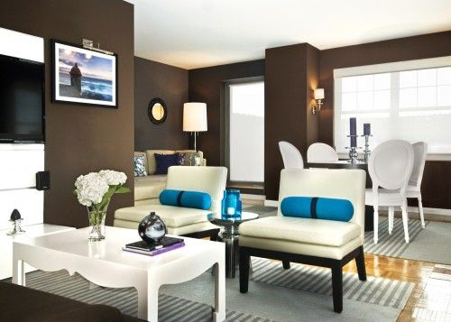 modern brown living room. Modern Living Room  The brown wall color is stunning against the cream decor with teal accents Paint SW French Roast 6069 or BM Black Be