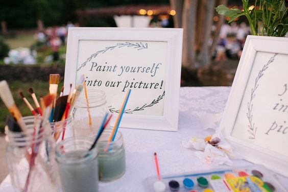 We LOVE this fun guest book idea! Guests paint themselves into the picture!