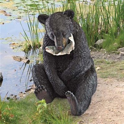 """""""The Expert Fisherman"""" Black Bear Statue. This bear cub will have the fresh catch of the day! With a dinner fish in his grasp, our young black bear will happily sit beside your pond or woodland path. #blackbear #fishing #gardenstatue"""