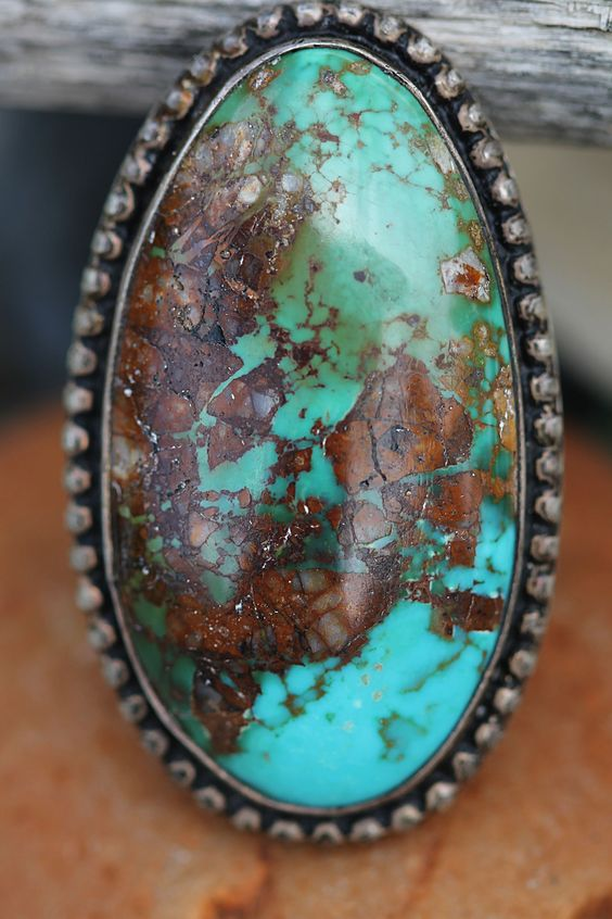 "Early New Mexican Navajo sterling silver and turquoise ring. Shank is hand-pulled wire. Size: 7; Weight,19.5 grams. Measures: 2.25"" L x 0.75"" W Great condition."