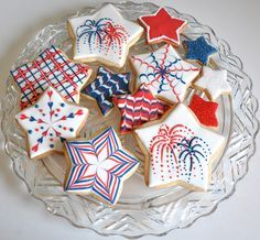 Fourth of July decorated sugar cookies. Royal icing. Red, white, blue. Star. Marbled, stripes, lattice, fireworks.