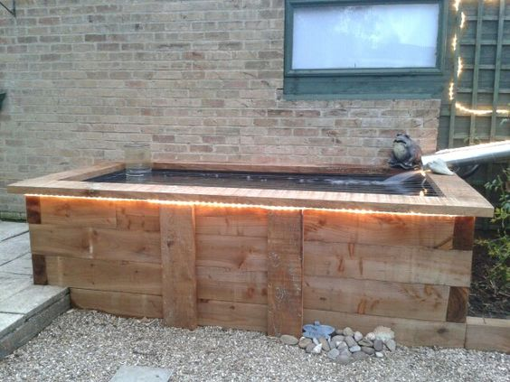 Fish pond made from upcycled railway sleepers my for Koi pond maker