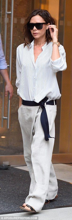 Victoria Beckham in cotton shirt and linen trousers from her own collections.