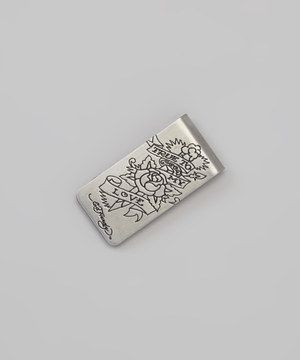 This sleek money clip is graced with an artistic tattoo image and the on-trend Ed Hardy logo, blending masculine fashion and business bravado to perfection.