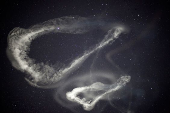 This photo provided by NASA shows chemical tracers that were released from five rockets launched from NASA's Wallops Island test flight facility in Atlantic, Va.