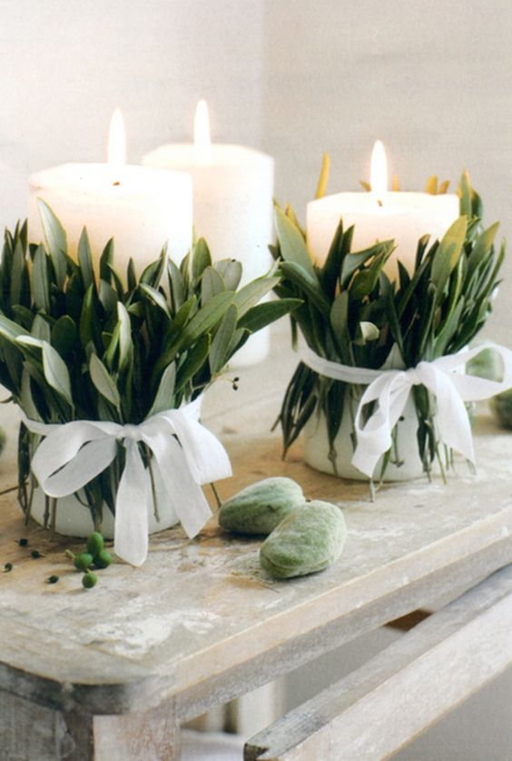 Go dreamy with some foliage-wrapped candles as centerpieces.: