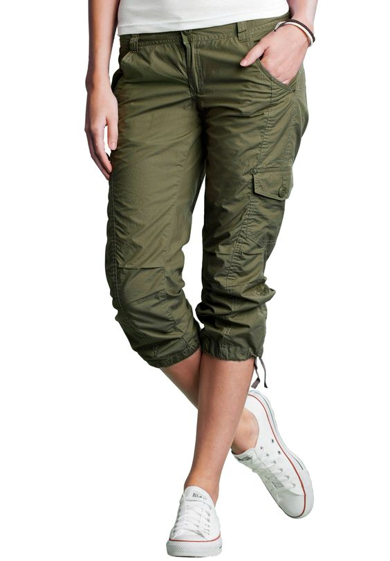 I have found Dorothy Perkins maternity combat trousers to be good for walking. Not tight around your bump, and loose enough but not too loose for walking. They don't zip off, but have buttons so you can roll the legs up to just below the knee.