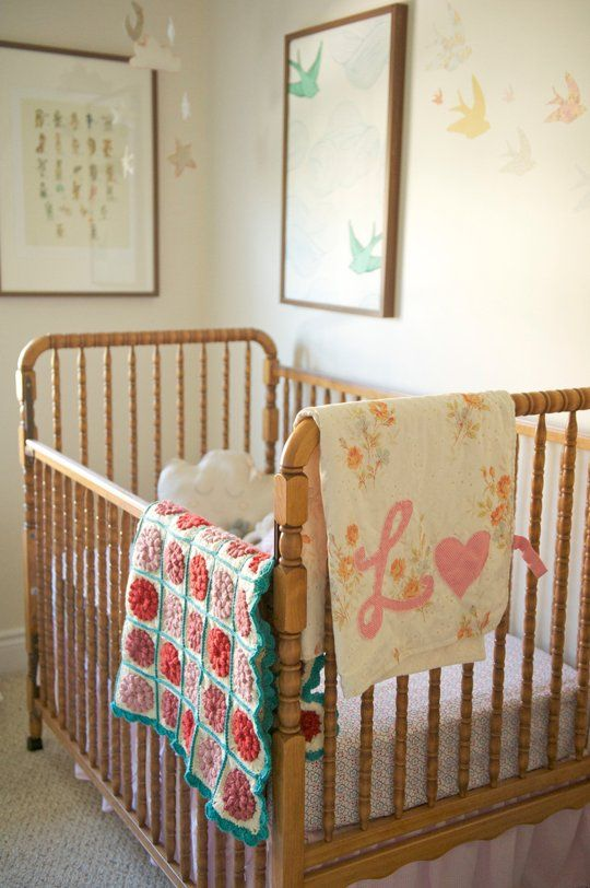 The square blanket is beautiful, colours are so sweet. (Lorelai's Thrifted, Vintage-Inspired Nursery, Apartment Therapy)