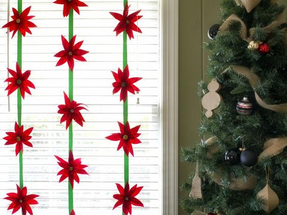 Dress up your walls, banisters or doors this holiday season with handmade felt poinsettias.