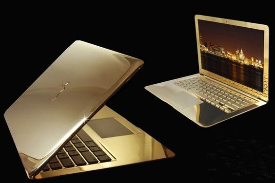 Made of 24-carat gold, set with a gold Apple logo encrusted with 25.5-carat flawless diamonds, Stuart Hughes' design weighs a mere 2.6kg (only twice the weight of its stock sibling). Sadly, even at that price it lacks Ethernet, has no optical drive and boasts one measly USB port.