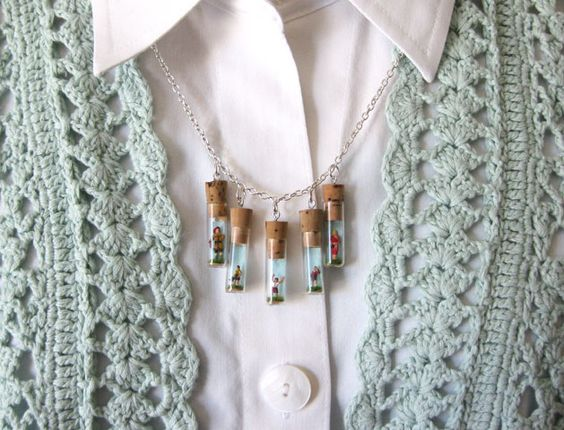 Miniature family in glass vials on necklace!!!  Crazy, but intriguingly cool.