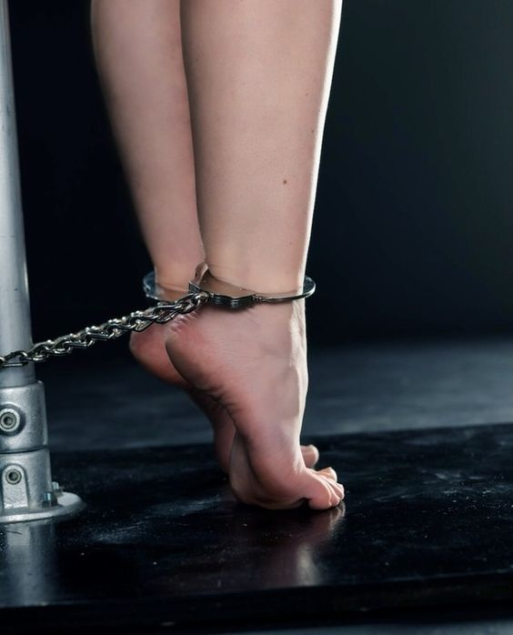 naked girl cuffed to pole