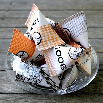 Tutorial to make these containers from scrap booking paper.  Fill with after dinner mints, wrap twine around the top of them (loosely) with a paper tag maybe saying what kind of treat is in them.
