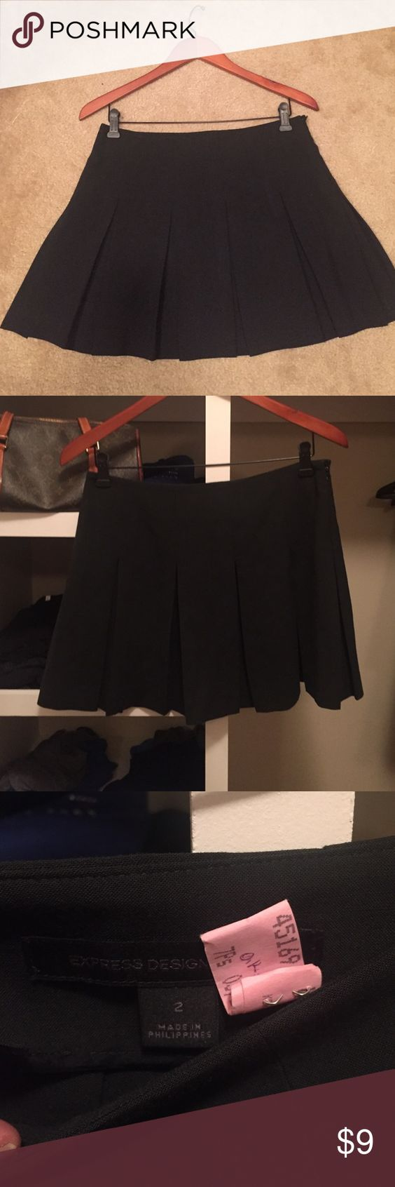 Express mini skirt- SALE Beautiful mini skirt from Express. Dark grey color. Large pleads. Smoke and pet free house. Great condition. Dry cleaned and ready to be worn Express Skirts