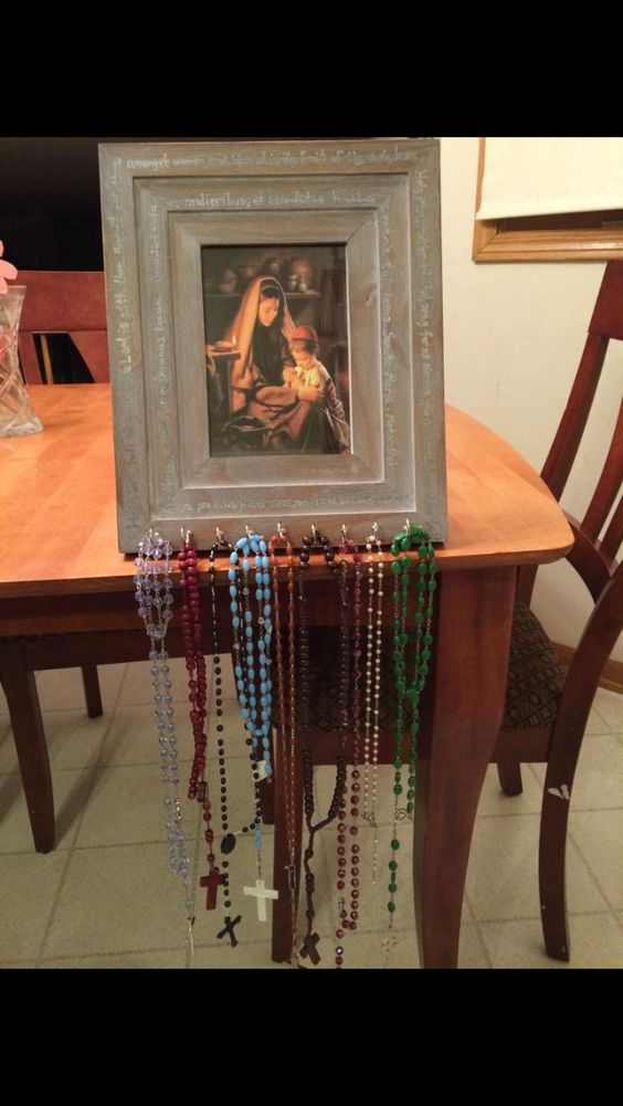 "I can't wait to make one! ""Rosary Frame"" Inexpensive frame, small cup hooks, framed Marian image and ""Hail Mary"" prayer written on frame. Created by a mom in my Catholic Homeschool FB group."