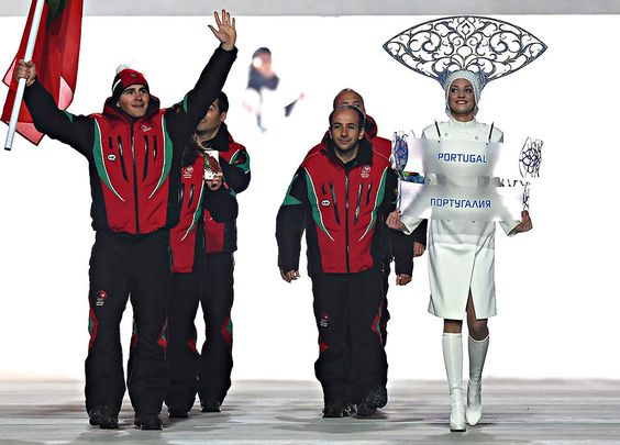 Skier Arthur Hanse of the Portugal Olympic team carries his country's flag during the Opening Ceremony of the Sochi 2014 Winter Olympics at ...