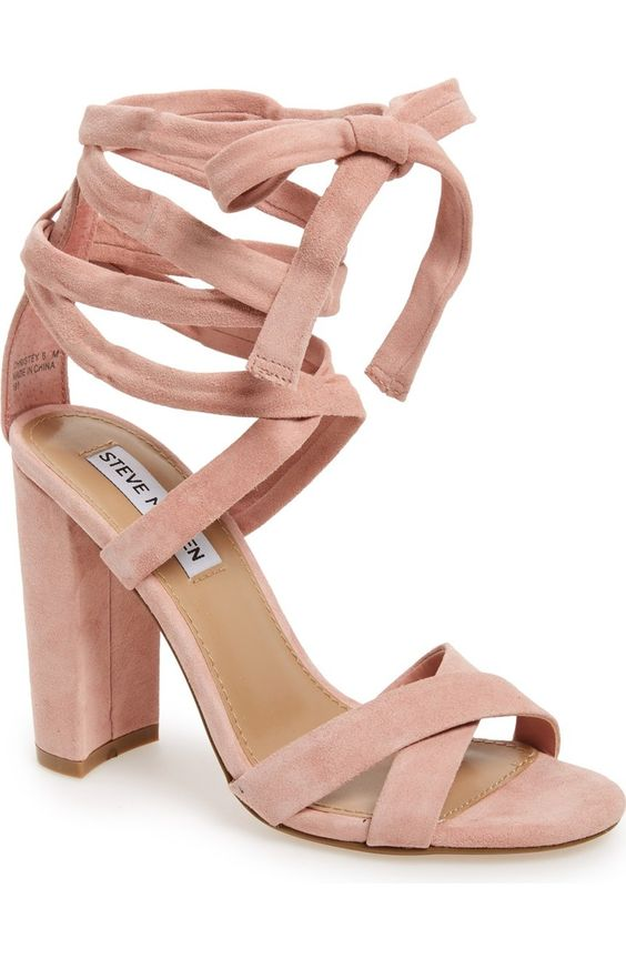 A wrapped, half-moon heel grounds this trend-right suede sandal topped with crisscrossing toe straps and leg-flattering wraparound ankle ties.