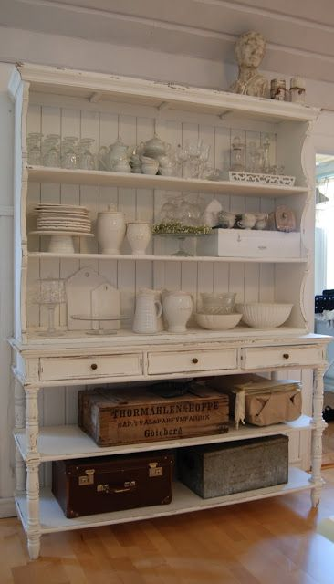 ♕ beautiful cabinet in Swedish home ~ Romantiska Hem. ☆☆Dishes organized in clear,  whites,  and creams with vintage suitcases as additional storage AND decor'.