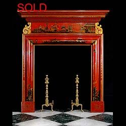 Early 19th century Neo Classical Chinoiserie red lacquered chimneypiece in the early Georgian manner with raised lacquer detail design depicting scenes from Chinese folklore on the frieze and jambs and ornately carved giltwood scrolls supporting the shelf. With restorations.   English circa 1820.