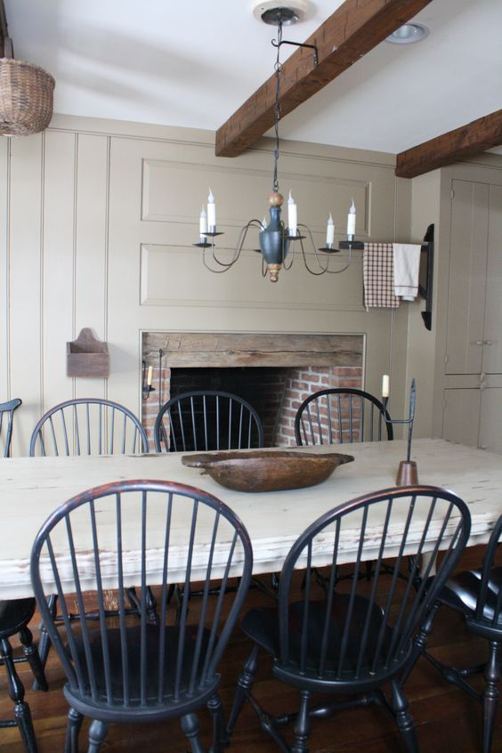 FARMHOUSE – INTERIOR – vintage early american farmhouse showcases raised panel walls, barn wood floor, exposed beamed ceiling, and a simple style for moulding and trim, like in this farmhouse dining room, love this look and color paint.