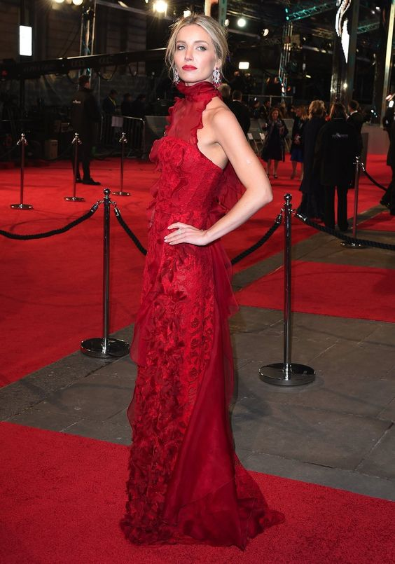 Annabelle Wallis - wearing this ruffled, scarlet red dress by Oscar de la Renta.