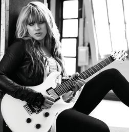 Orianthi Panagaris (born 22 January 1985), better known simply as Orianthi, is a Greek Australian musician, singer-songwriter and guitarist