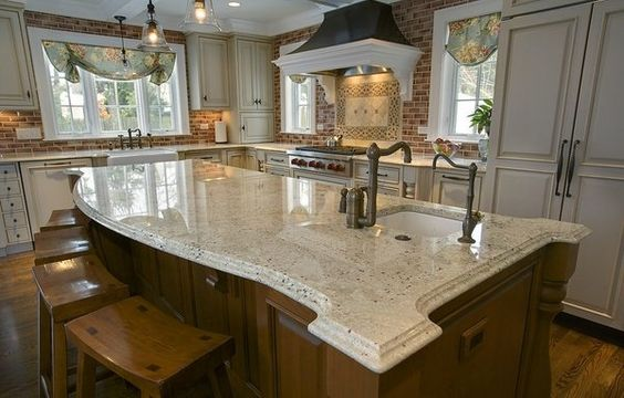 A little bit of lighter wood to go with the granite can be a fun accent with these white cabinets behind. For this one it seems to emphasize the white colors in this particular slab.