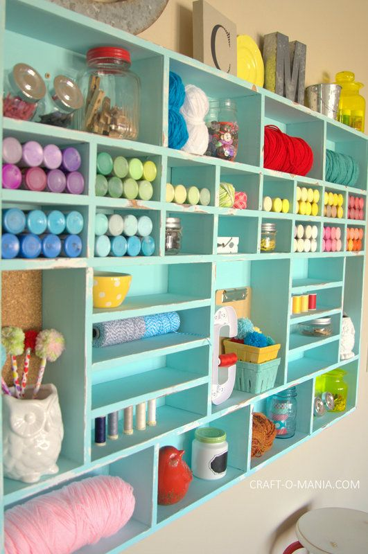 Jennie Larsen at Craft-o-Maniac rehabbed a thrifted wooden cubby unit with a fresh coat of turquoise chalk paint, which she sanded to give an antiquated look. It's roomy enough to accommodate lots of paints, twine, and more. - CountryLiving.com: