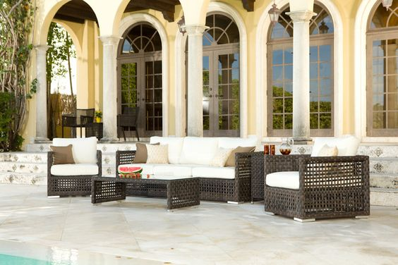 Chic 4 piece Cervino Wicker Sofa Set.  The dark hues of the wicker and creamy cushions are to die for!