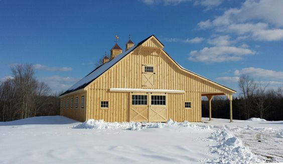 Our most recent horse barn  - 36x72 High Profile Modular with 12' overhang.  Pine board and batten exterior siding.  Includes:  9 stalls, wash bay, tack room, storage roof and 16' wide loft over the aisle.  Custom window, functional hay hoist and vented cupolas.