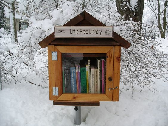 """Little Free Library. Rick Brooks and Todd Bol are the cofounders of the nonprofit Little Free Library. In 2009, they began fabricating and installing little libraries around Madison, WI. The libraries are essentially a nicely designed, weatherproof hutch mounted on poles, which contain a collection of about 20 books and a sign that reads """"Take a Book, Leave a Book."""" What a great way to enhance your neighborhood and create community!   www.littlefreelibrary.org: Little Free Libraries, Cute Ideas, Front Yard, Books Books, Book Exchange, Free Library"""