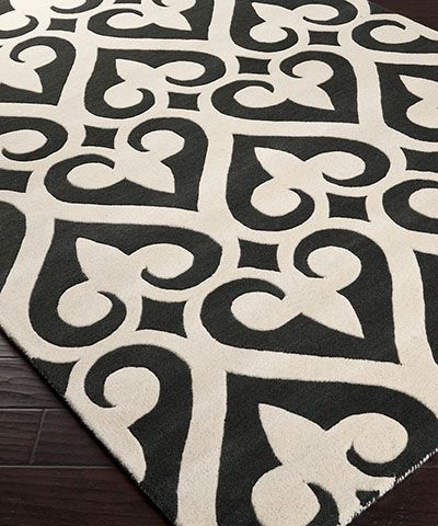 Zuna Rug - Black - Starkly stylish, the Zuna Rug in Black has a crisp presence on your floor, its unrelenting but curvaceous black and white pattern slightly carved for a tactile and noticeable element of design that makes the perfect backdrop to colorful furniture or achromatic accents. Hand-tufted construction from pure wool of New Zealand origin makes it a pleasure to tread.: