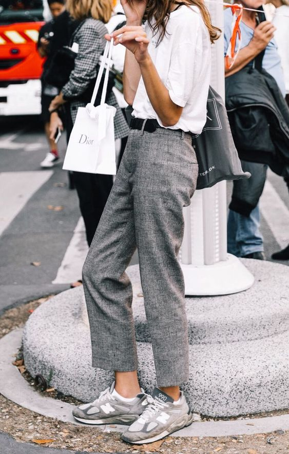 Summer city neutrals: white tee, menswear trousers, taupe trainers. Anchored by a little black leather. Pinterest: ange de la cuesta