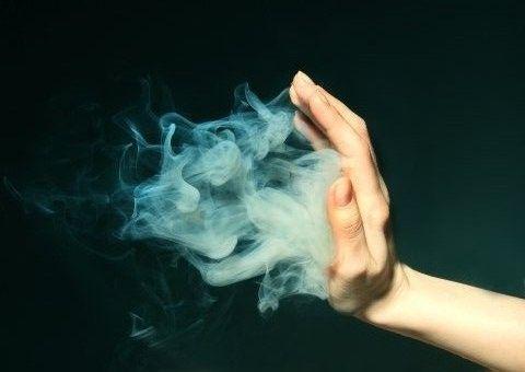 hand pushing smoke image