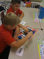 Game boards for word work - students roll the die, move their piece, and then read the next sight word on their individualized word ring. If they read it correctly, they stay on the space, if not, they go back where they were. (Or maybe have them read it first and THEN roll...?) Another great word work center for Daily 5