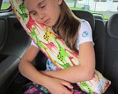 Seat Belt Pillow with pockets-velcros to the seatbelt. Cool!