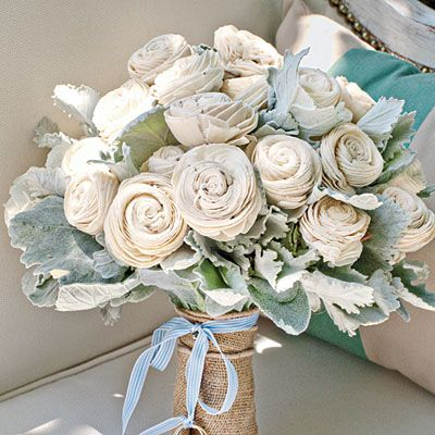 not so much the balsa wood flowers...but love the burlap and the (hard to see) wedding rings tied to the ribbon