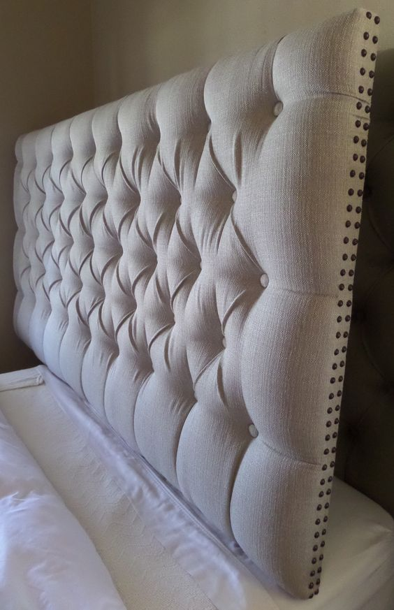 King sized extra thick extra tall tufted upholstered headboard neutral tan taupe nail head trim custom wall mounted