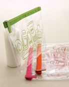 """I love these fun colored travel """"zip locks"""" from Neiman's.  So much more fun to go through security at the airport with these, than the real Ziplock baggies..."""