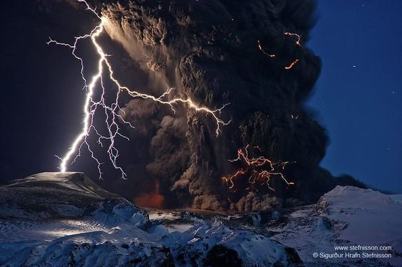 Pictured above during the second eruption, lightning bolts illuminate ash pouring out of the Eyjafjallajökull volcano.