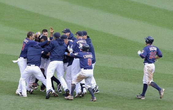 The Minnesota Twins celebrate a walk off win against the Milwaukee Brewers after fifteenth innings on June 17, 2012 at Target Field in Minneapolis, Minnesota. The Twins defeated the Brewers 5-4 in fifteenth innings.