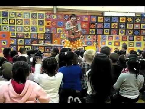 """""""Glad I'm at School"""" song by Debbie Clement, during Author-Illustrator School Visit! (Kindergarten students made HUGE back-drop of quilt squares in reference to Debbie's first picture book: """"You're Wonderful"""")"""