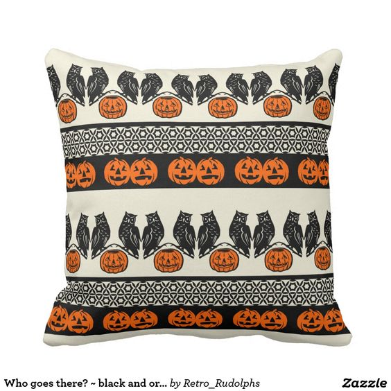 Who goes there? ~ black and orange on cream