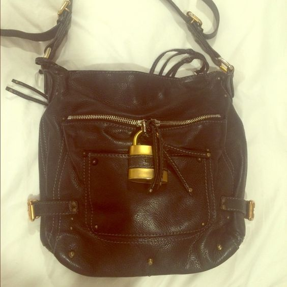 Chloe Paddington Black Shoulder Bag Pebble leather Paddington hobo/shoulder bag with classic Chloe Padlock hardware and key. This bag has tons of pockets for organization. It's in good condition. Some of the gold finish on the buckles has started to wear off (pictured) Chloe Bags Shoulder Bags